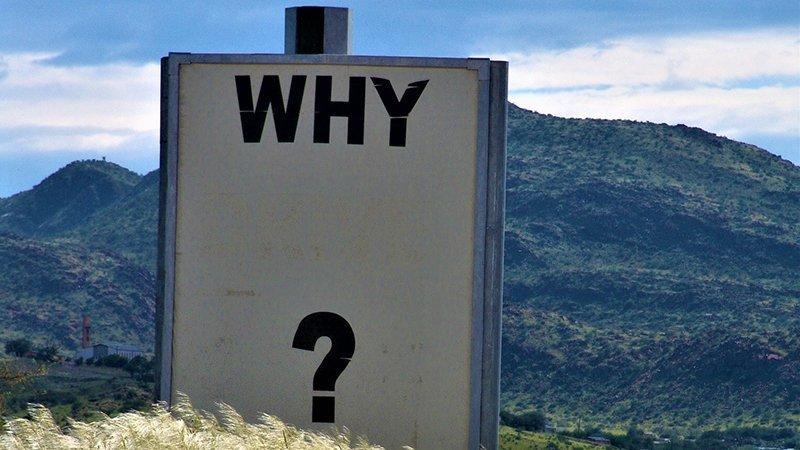 """Fotografía de un cartel con el mensaje """"Why?"""""""
