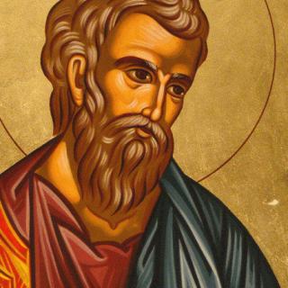 Detalle de una estampita de San Mateo donde sale ilustrado con cara de santo y un circulito sobre la cabeza