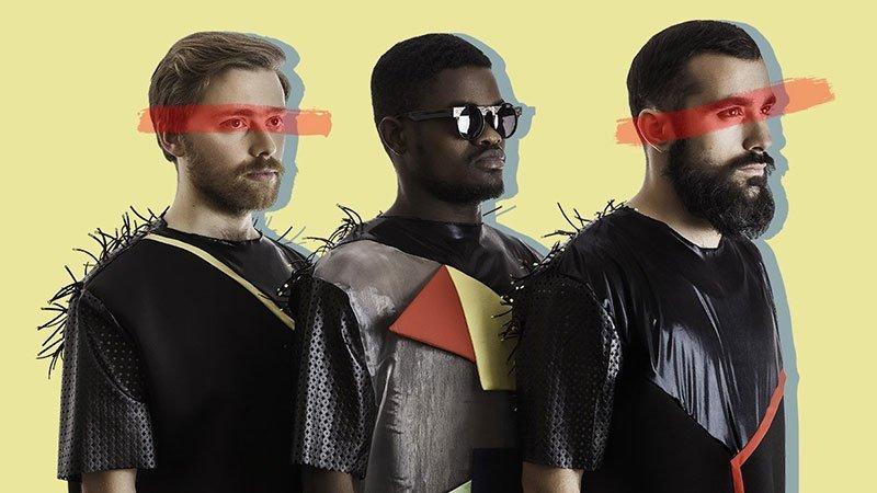 Imagen promocional de Throes + The Shine en la que se ve a los tres integrantes de la banda de perfil, recortados sobre un fondo amarillo y con una franja roja sobre los ojos